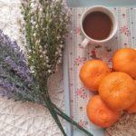 fresh-fruit-orange-beside-porcelain-mug-3669374-1