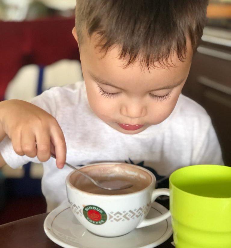 child having hot chocolate